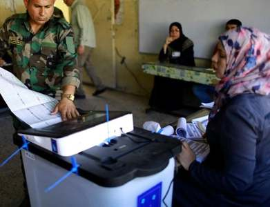 Iraqis vote in parliamentary election, low turnout reflects apathy