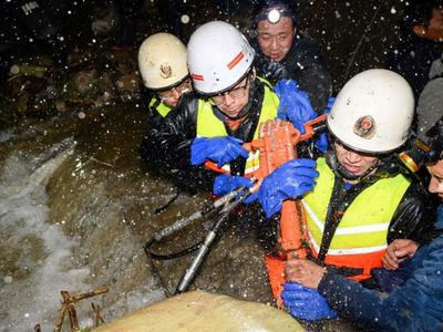Thousands evacuated and coal mines shuttered as floods hit north China