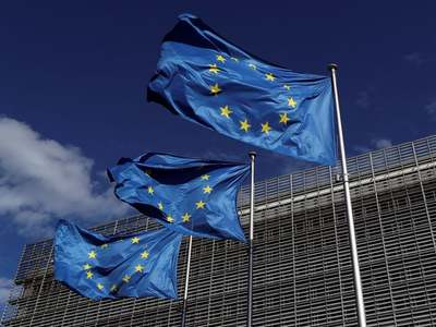 EU carries out anti-trust raids on paper giants