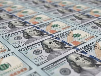 Dollar trades near one-year high after inflation data; Fed minutes on tap