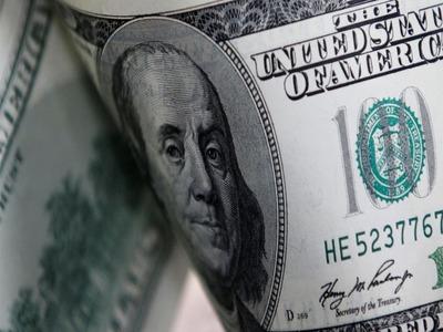 Dollar dips in choppy trading as risk appetite improves