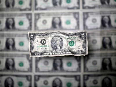 Dollar edges lower after weak US factory production data