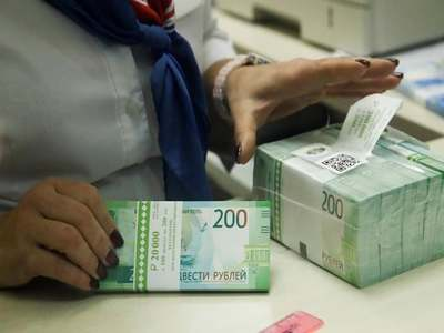 Russian rouble firms past 71 vs dollar