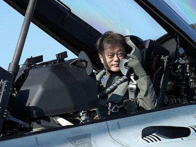 Arriving in fighter jet, South Korea's Moon urges defence industry growth