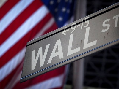 Wall Street closes higher as earnings reports soothe investor fears