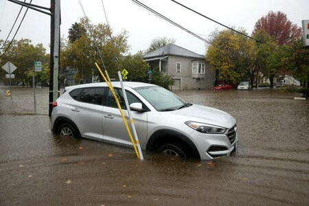 Mudslides, power outages as storm drenches burn-scarred California