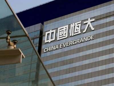 Evergrande, EV unit shares jump after chairman signals business shift