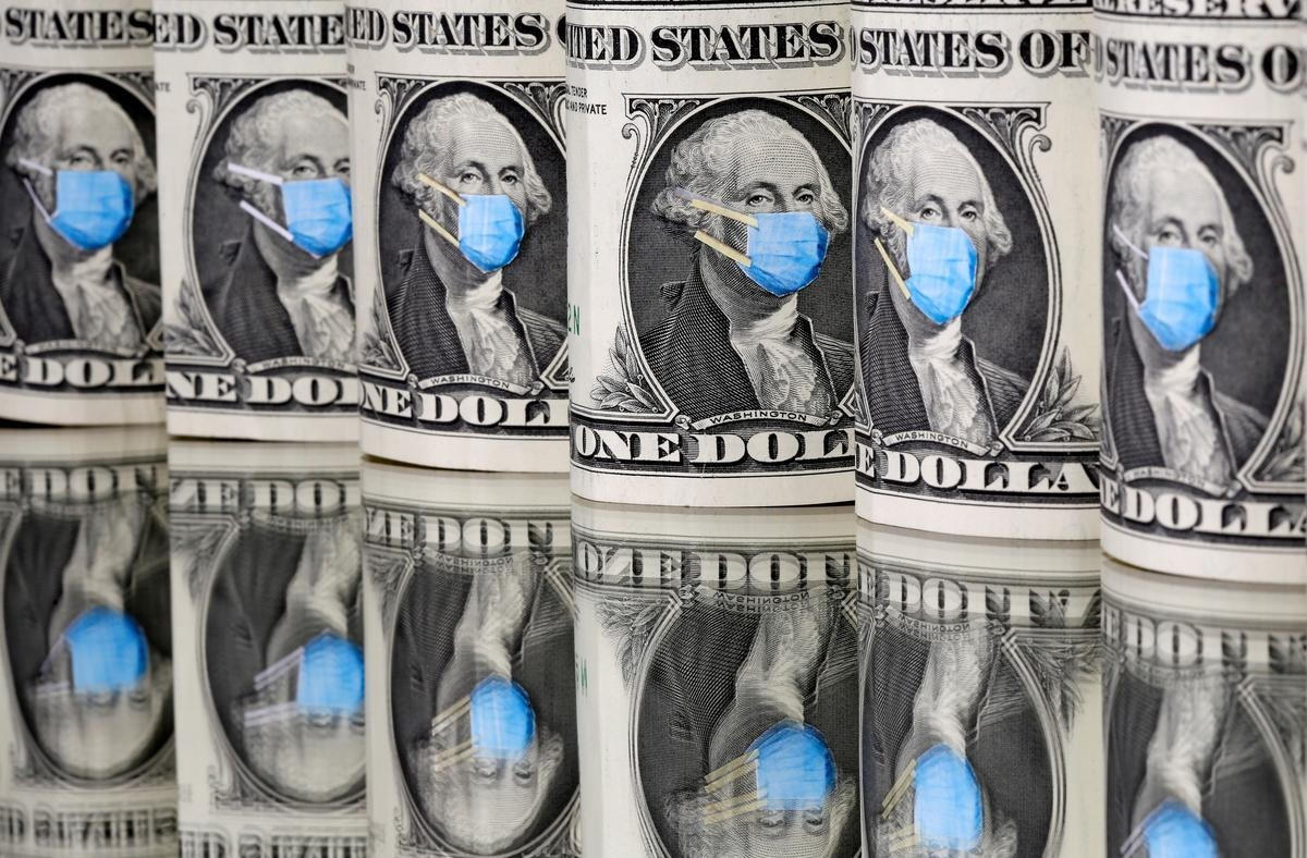 FILE PHOTO: George Washington is seen with printed medical mask on the one Dollar banknotes in this illustration taken, March 31, 2020. REUTERS