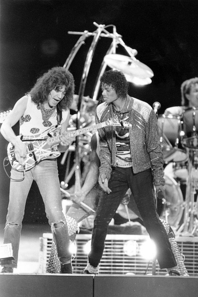 """Van Halen guitarist Eddie Van Halen, left, performing """"Beat It"""" with Michael Jackson during Jackson's Victory Tour concert in Irving, Texas on July 14, 1984."""
