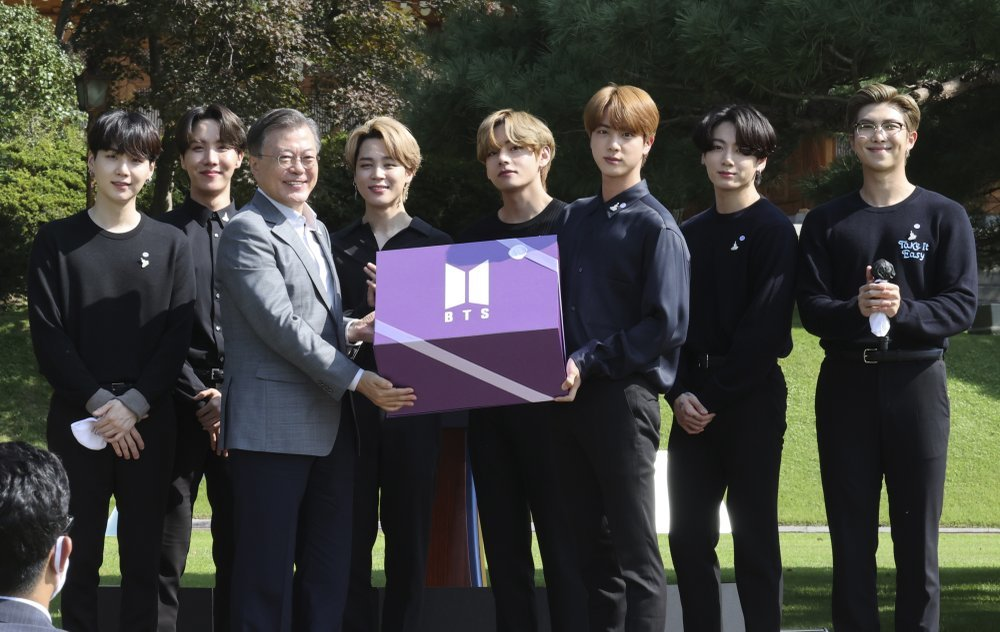 South Korean President Moon Jae-in, third from left, receives a gift from members of K-Pop group BTS during a ceremony marking the National Youth Day at the presidential Blue House in Seoul on South Korea Sep 19, 2020.—AP