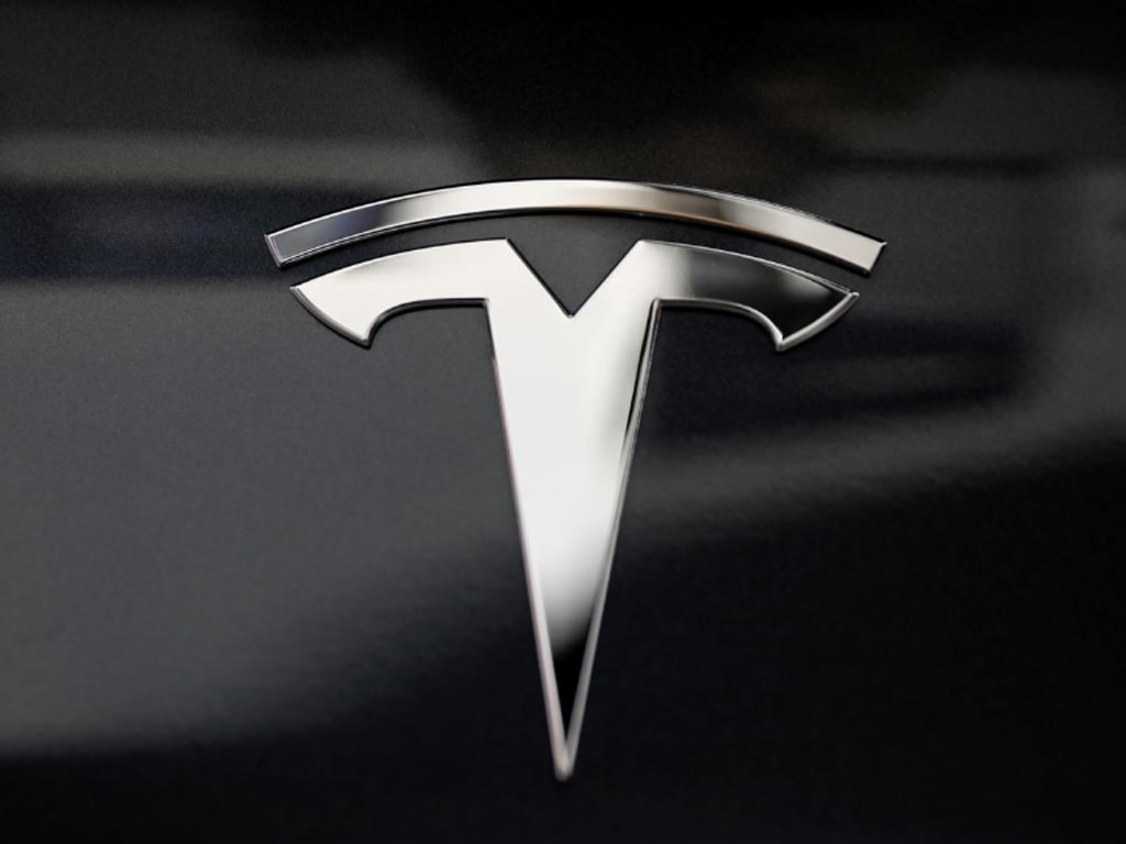 Tesla shares rise in busy trade ahead of S&P 500 debut