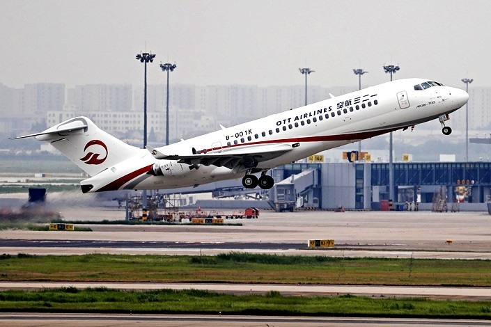 China completes maiden flight for passenger jet, challenging global aviation giants