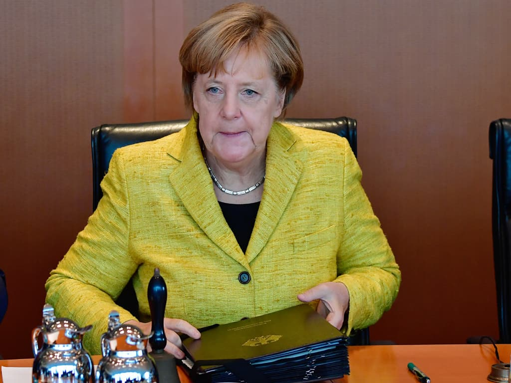 Merkel party suffers losses in two German state polls