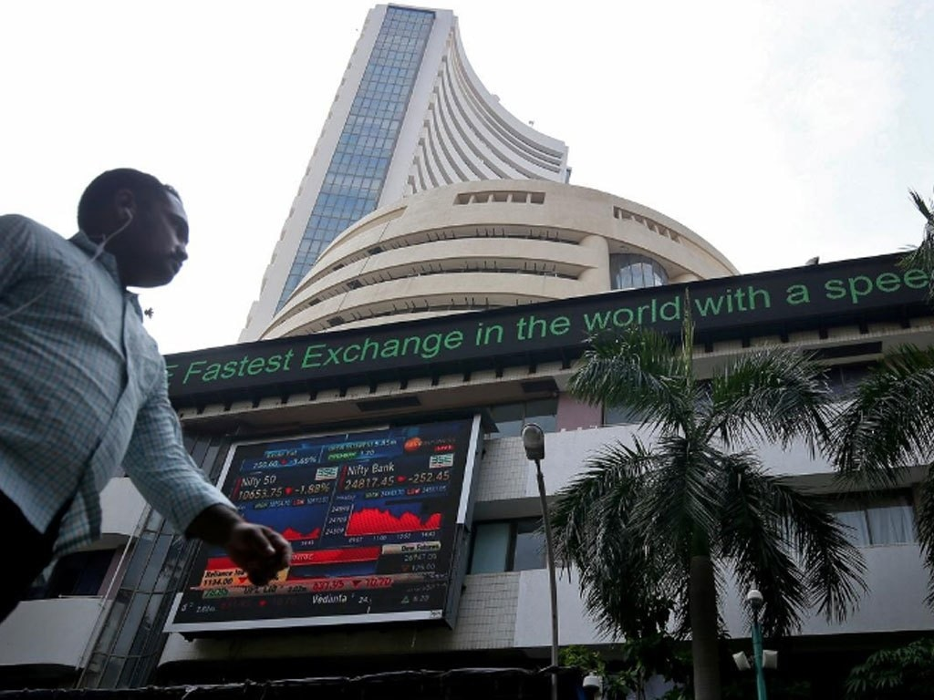 Indian shares edge up in volatile trade; Future Group firms slide