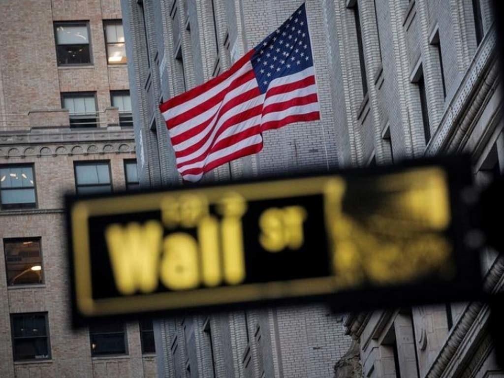 Wall Street rallies; Tesla gains