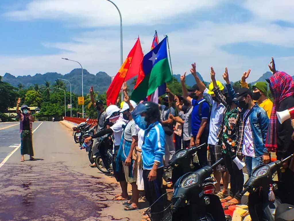 Myanmar activists splash red paint to protest junta bloodshed