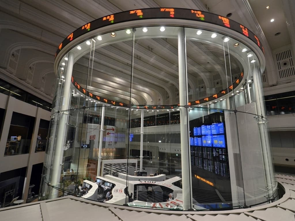 Tokyo shares open down ahead of corporate results