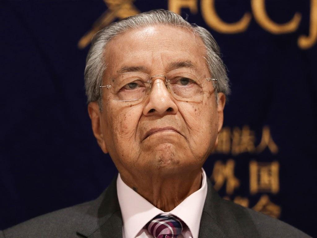 Malaysia's Mahathir urges king to lift virus emergency