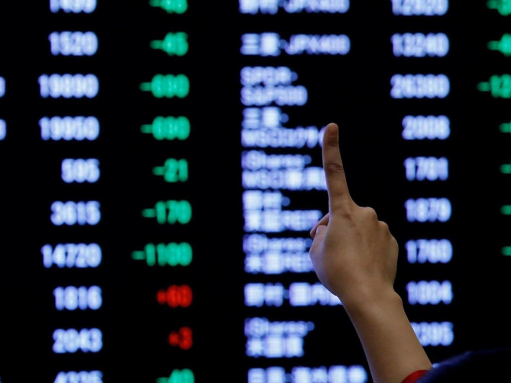 World shares near record high on Fed, earnings, but Asia slips