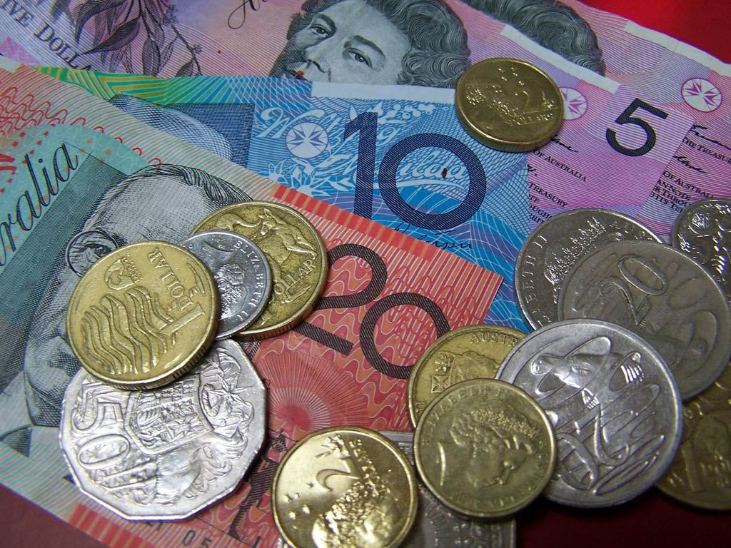 Australia dollar sags as RBA stays super loose while upgrading economic outlook