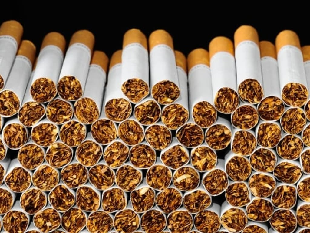 Cigarette cos luring youth with low-priced brands, cash prizes