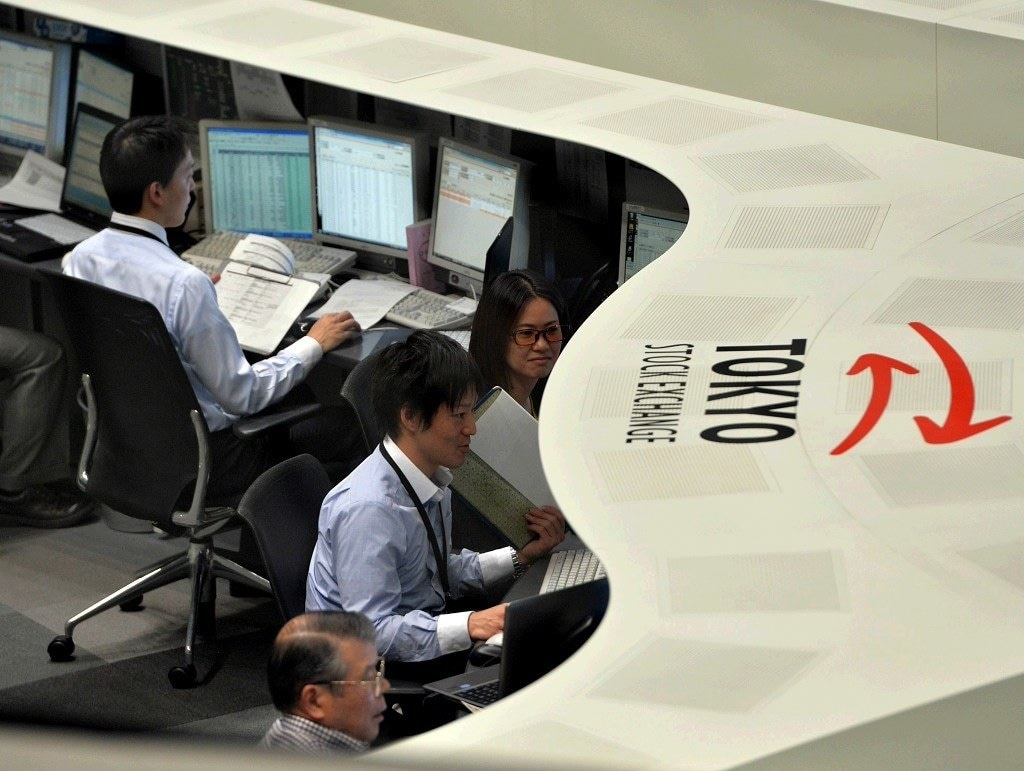 Japanese shares edge down as tech stocks weigh