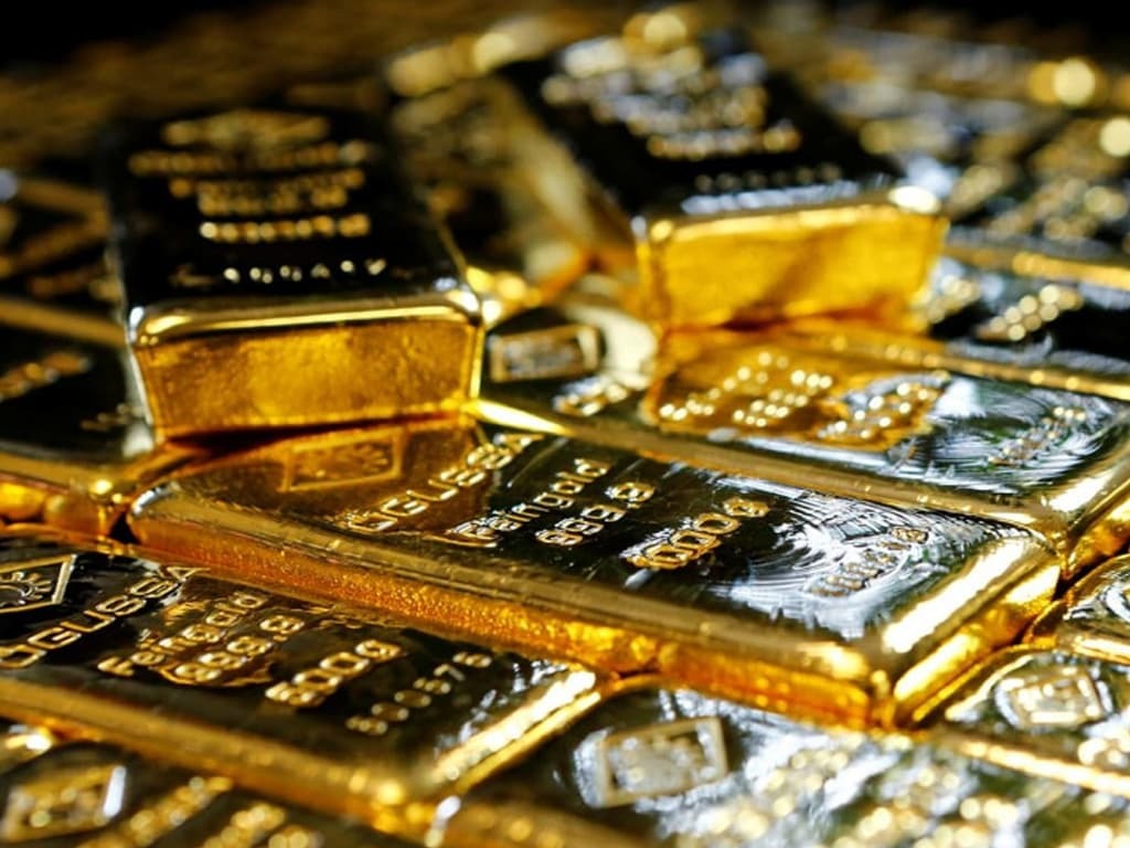 Gold firms after US CPI surge; strong dollar limits gains