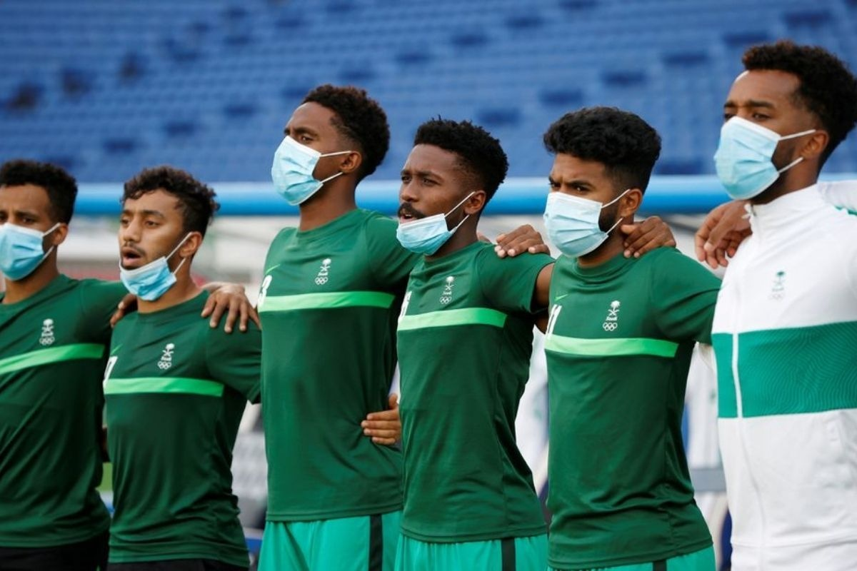 Saudi Arabia players line up for the national anthems before a match against Ivory Coast on July 22.—Reuters