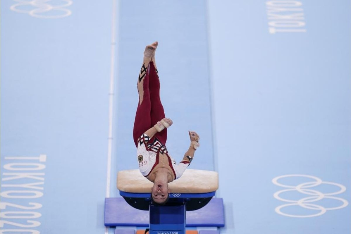 Kim Bui, of Germany, performs on the vault during the gymnastic qualifications