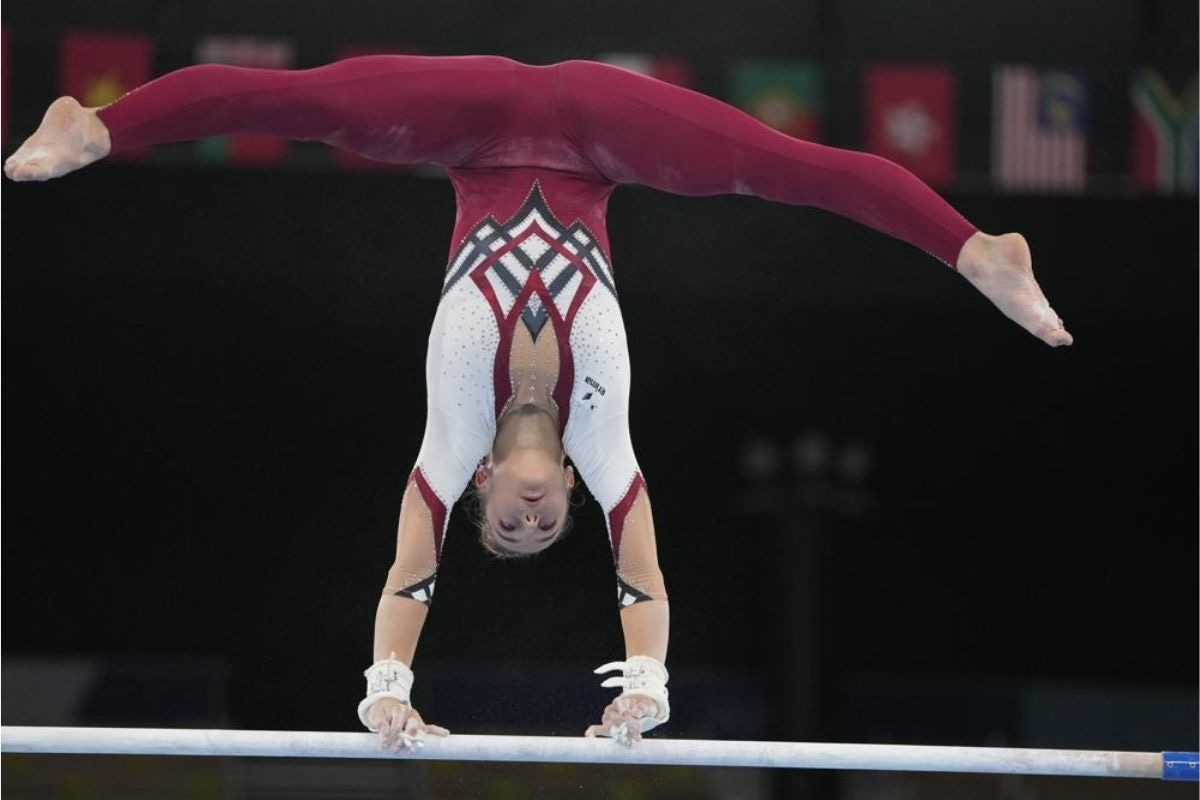 Pauline Schaefer-Betz, of Germany, performs on the uneven bars during the gymnastic qualifications
