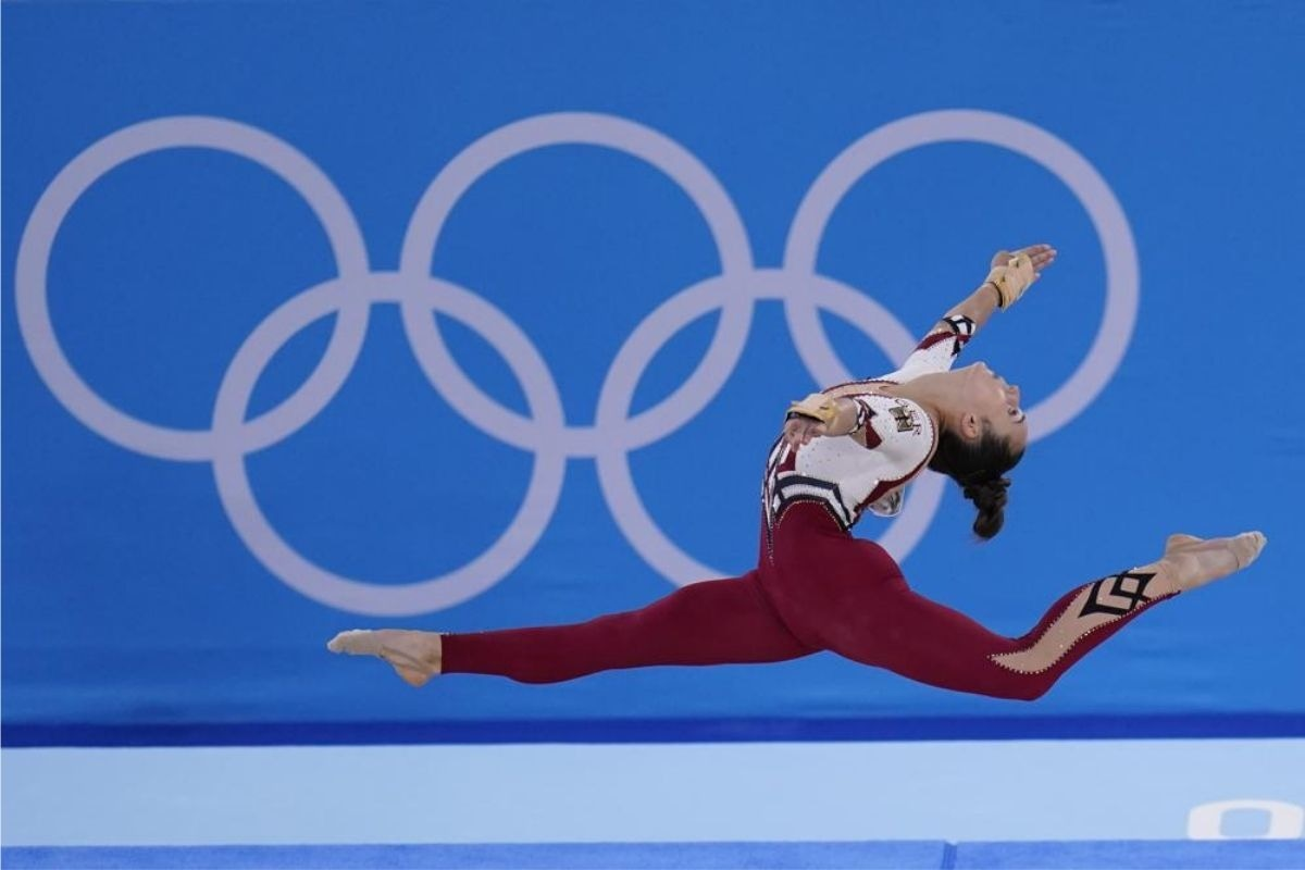 Pauline Schaefer-Betz, of Germany, performs her floor exercise routine during the gymnastics qualification
