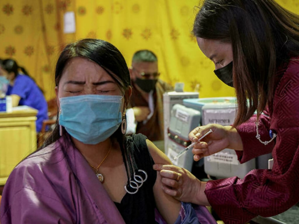'Success story': Bhutan vaccinates most of population after donations