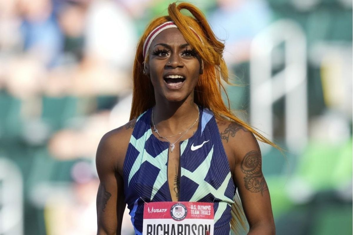 Sha'Carri Richardson celebrates after winning the first heat of the semis finals in women's 100-meter run at the U.S. Olympic Track