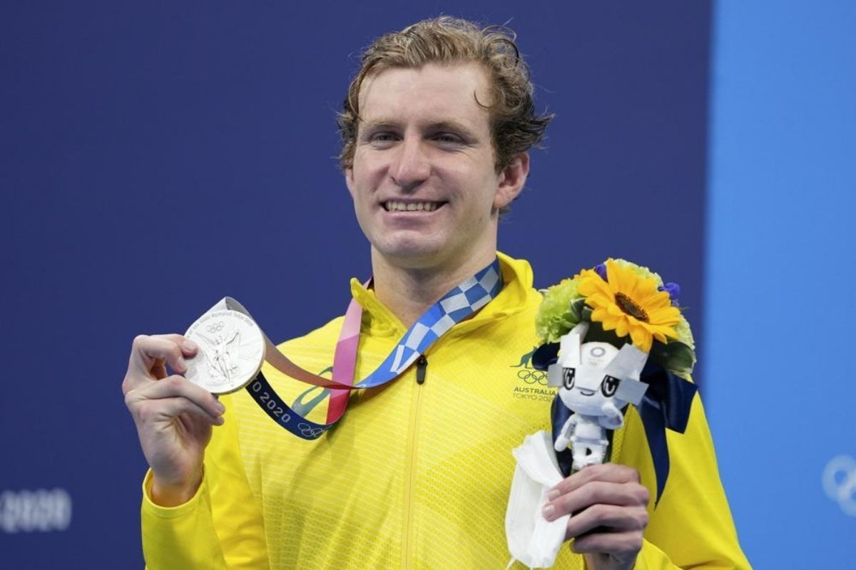 Jack McLoughlin, of the Australia, holds his silver medal on the podium after the final of the men's 400-meter freestyle
