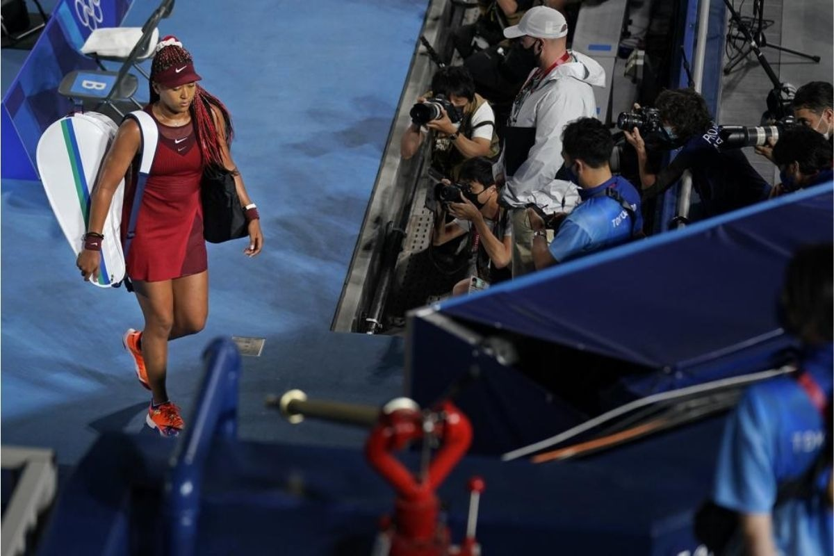 Naomi Osaka, of Japan, leaves center court after being defeated by Marketa Vondrousova