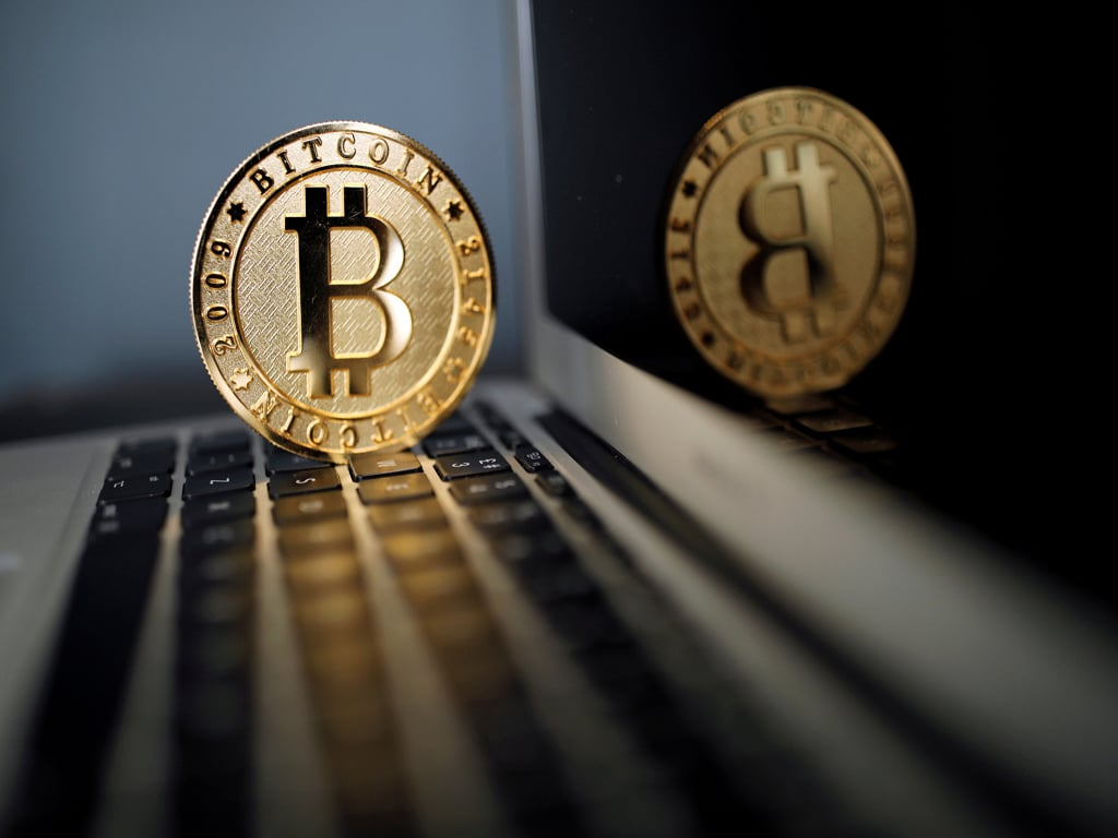 Bitcoin trading subdued after chaotic debut, Coinbase faces lawsuit