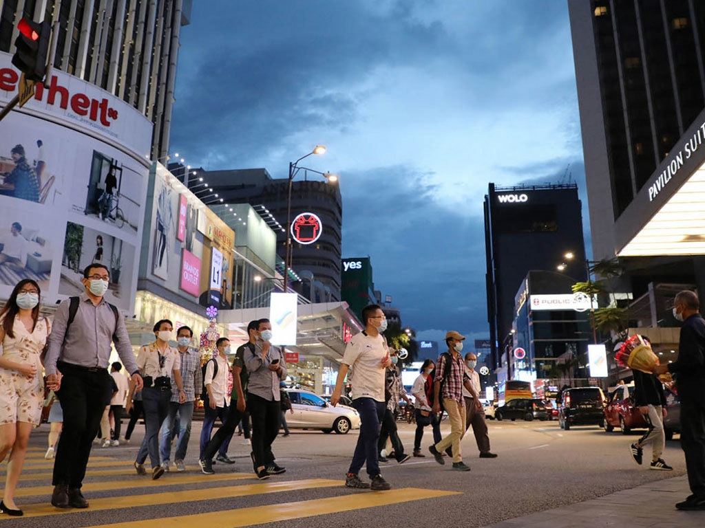 Malaysia eases travel curbs as Covid outbreak slows