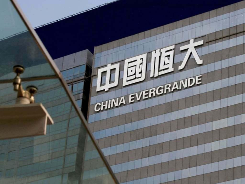 Stocks split as Evergrande fears recede
