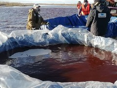 Russia struggles to clean up Arctic river fuel spill