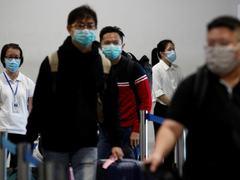 FBI chief says China threatens families to coerce overseas critics to return to China