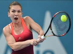 Halep labours to victory on comeback at Prague Open