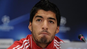 Suarez double fires Atletico seven points clear