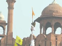 Chaos in New Delhi as protesting farmers hoist Khalistan flag on Red Fort