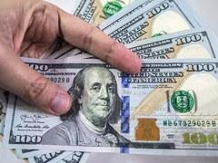 Dollar slumps to 6-week low, Bitcoin steadies after weekend drop