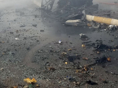 At least 11 killed as roadside bomb hits bus in Afghanistan